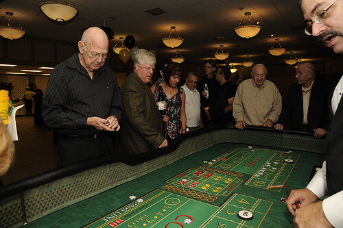 Group of elderly people playing roulette in a casino