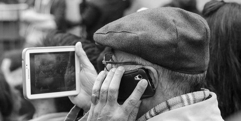 Gambler holding mobile